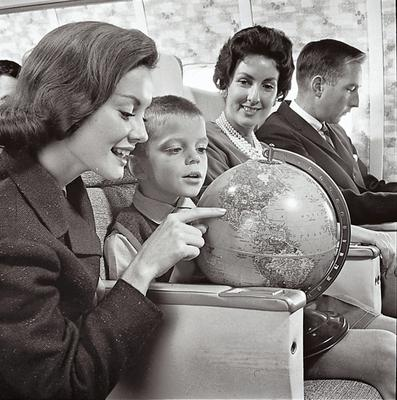 An air hostess for the airline points out the route to a young traveller in the 1960s.   Photo courtesy of Doesn't Time Fly? Aer Lingus - Its History by Mike Cronin