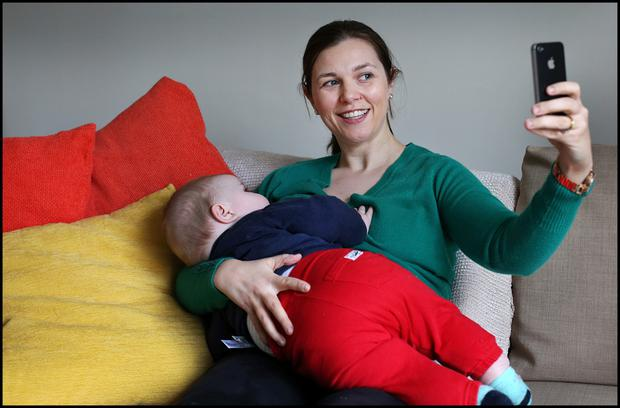 Chrissie Russell and her baby Tom pose for a brelfie