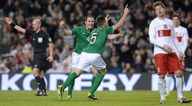 Ciaran Clark celebrates with John O'Shea after scoring the Republic of Ireland's first goal in a 2-0 win, the last time Poland visited the Aviva Stadium in 2013. Photo: Matt Browne / SPORTSFILE