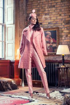 Wool-boucle coat, €2,200; silk-and-lame brocade top, €795; silk-and-lame brocade trousers, €995, all Jen Kelly. Shoes, €169, Fitzpatricks Shoes. Hat, €285, Polly McGettigan. Amethyst and emerald earrings, €8,500, John Farrington