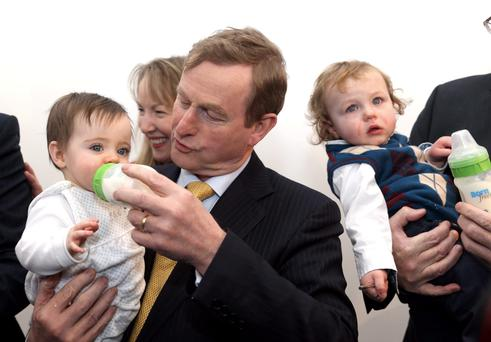 Taoiseach Enda Kenny bottlefeeds a baby at the launch of Glanbia's new infant formula plant at Belview, Co. Kilkenny. Photo: Jason Clarke