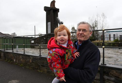 Family pride: Pat English with his grandaughter Robyn, who is wearing her great grandfathers medals