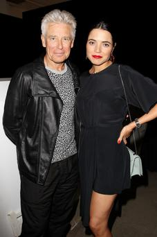 Swish bash: Adam Clayton and his wife Mariana