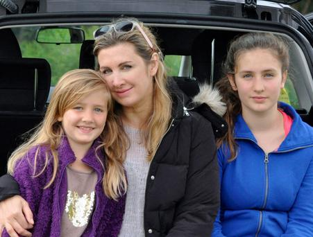 Mum's the word: Carey with her daughters Clio and Lily.