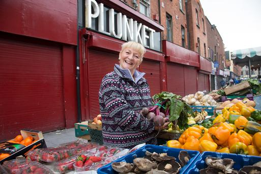Marie Cullen, fourth-generation trader on Moore Street, is situated outside Nos 14-17, the 1916 buildings that will be turned into a commemorative centre for the Easter Rising