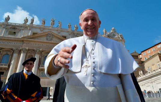 REACHING OUT: Pope Francis greets the faithful as he leaves St Peter's Square at the Vatican
