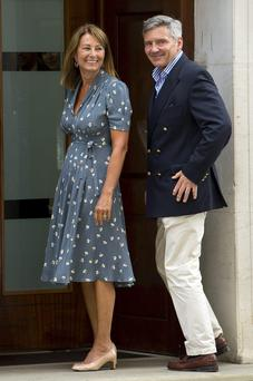 Mum's the word: Carole Middleton, who has undoubtedly been a help to Kate and Prince William since George was born, pictured with her husband Michael
