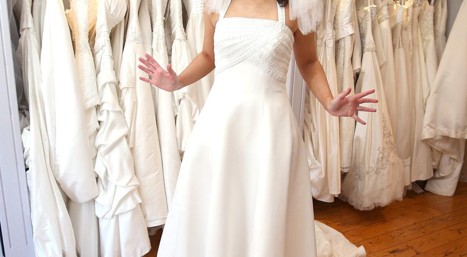 Reluctant bride: Joanna Kiernan tries on wedding dresses at the Barnardos Bridal Rooms in Dun Laoghaire. Photo: Damien Eagers