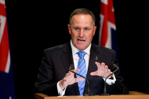 Tug of war: New Zealand Prime Minister John Key who says he pulled a waitress's ponytail as a bit of banter