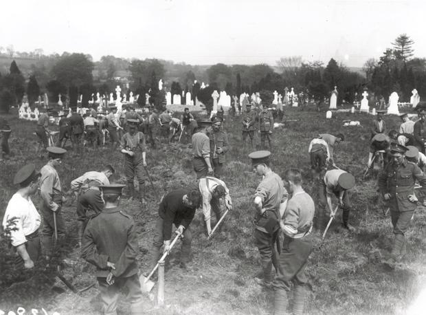 Soldiers dig the graves in an old churchyard in Queenstown for the victims of the Lusitania disaster.