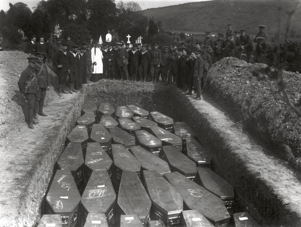 Servicemen attend the funeral in Cobh, County Cork of the victims of the Lusitania disaster