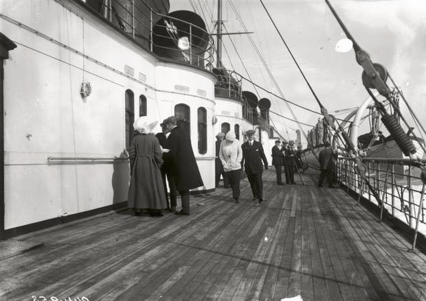 Passengers on the promenade deck of the RMS Lusitania in June 1912.
