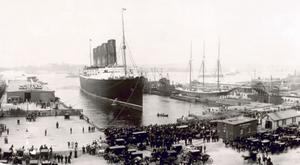 The Lusitania docks in New York after its world record-breaking maiden voyage.