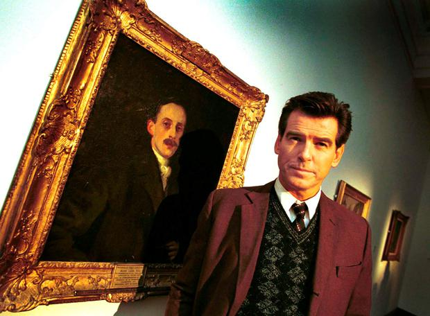 Pierce Brosnan beside a portrait of Hugh Lane in the Gallery, where the actor shot scenes for the movie 'Evelyn'.