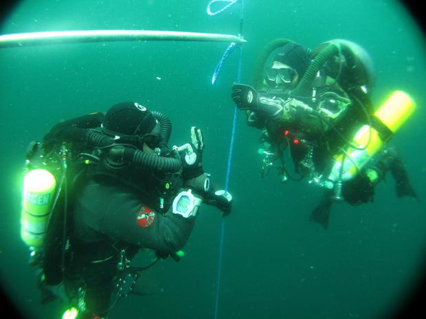 Tim Carey's photo of divers Richard Wakefield and Steve Phillips on one of his many dives to the Lusitania wreck, where his team brought to the surface