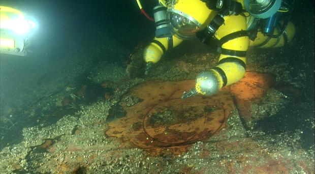 11 miles off the coast of Kinsale in the Irish sea: A Newtsuit at sea floor examining the Lusitania wreckage.