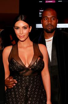 One is not amused: Kim and Kanye didn't see the funny side when Amy Schumer threw herself at their feet
