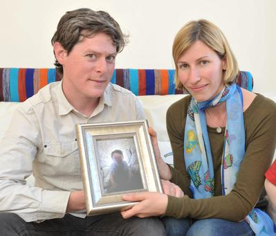 Barry and Sheila Boland with a portrait of their late son Oisin