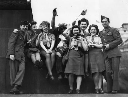 Party time: British women and soldiers celebrate V-E day in Trafalgar Square, London