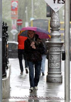 Downpour: Members of the public brave the bad weather in Dublin city centre this afternoon