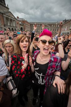 Carly Moffitt and her partner Jennifer Cleary from Dublin celebrate after the announcing the reults of same-sex marriage referendum at Dublin Castle. Photo: Mark Condren