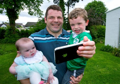 Mike with his two children, four-year-old son Kevin and seven-month-old daughter Chloe, taking his selfie for Anam Cara's #daddyandme campaign. Photo: Colm Mahady