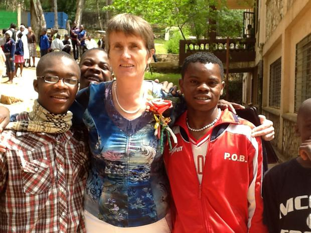 Gena Heraty with Watson, Michel and Jeff on the day she celebrated 20 years at the orphanage.