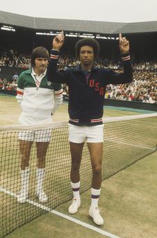 Arthur Ashe raises his hands in victory after beating Jimmy Connors in the 1975 Wimbledon final.