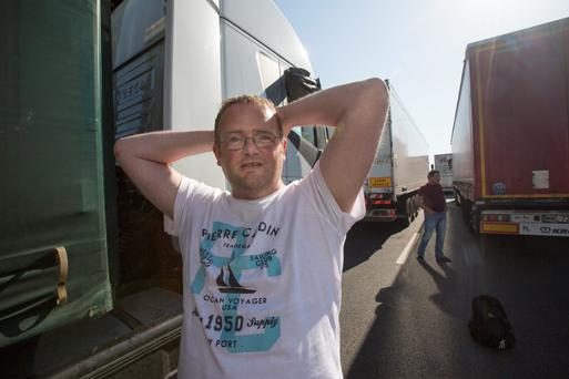 Waiting game: Trucker James Reilly from Co Cavan said two migrants tied themselves to his lorry in Calais