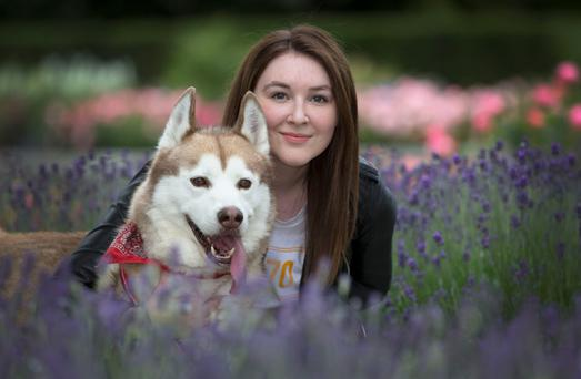 They call it puppy love: Eva Hall and her 30kg Husky dog, Clint. Photo: Colin O'Riordan