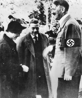 The Duke and Duchess of Windsor are greeted by Adolf Hitler on a tour of Germany in 1937. Photo: Getty Images.