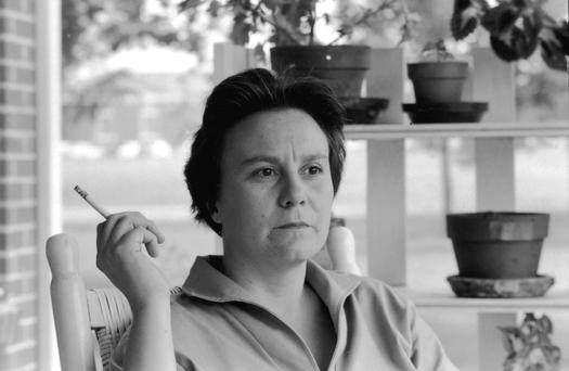 Harper Lee smokes a cigarette as she sits on the porch of her parents home in Monroeville, Alabama in 1961, a month after 'To Kill a Mockinbird' was awarded the Pulitzer Prize in fiction.