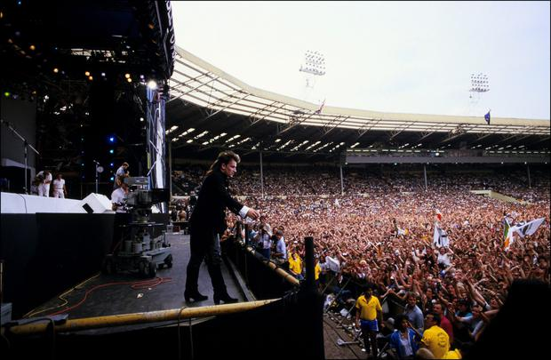 Sea of people: Bono performs to a packed Wembley for Live Aid in 1985