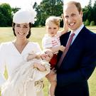 Britain's Prince William and Catherine, the Duchess of Cambridge, with their children, Prince George (2nd R) and Princess Charlotte, who was christened at Sandringham, are seen in this handout photo released on July 9, 2015. Mandatory credit. REUTERS/Mario Testino/Art Partner/Handout via Reuters TPX IMAGES OF THE DAY