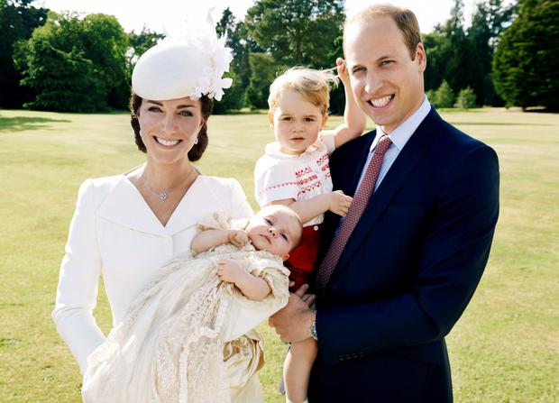 July 2015: Britain's Prince William and Catherine, the Duchess of Cambridge, with their children, Prince George (2nd R) and Princess Charlotte, who was christened at Sandringham, are seen in this handout photo released on July 9, 2015.