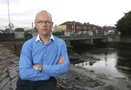 Stephen McCullogh pictured next to Annesley Road Bridge, the former battlefield site just outside his grandparents' house where they were trapped for four days during The Rising. Photo: Damien Eagers