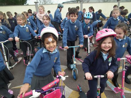 Pupils on their scooters at Scoil Inse Ratha, Cork