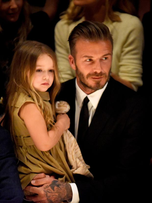 Papa don't preach: David Beckham has hit back at critics after daughter Harper (4) was pictured using a soother.