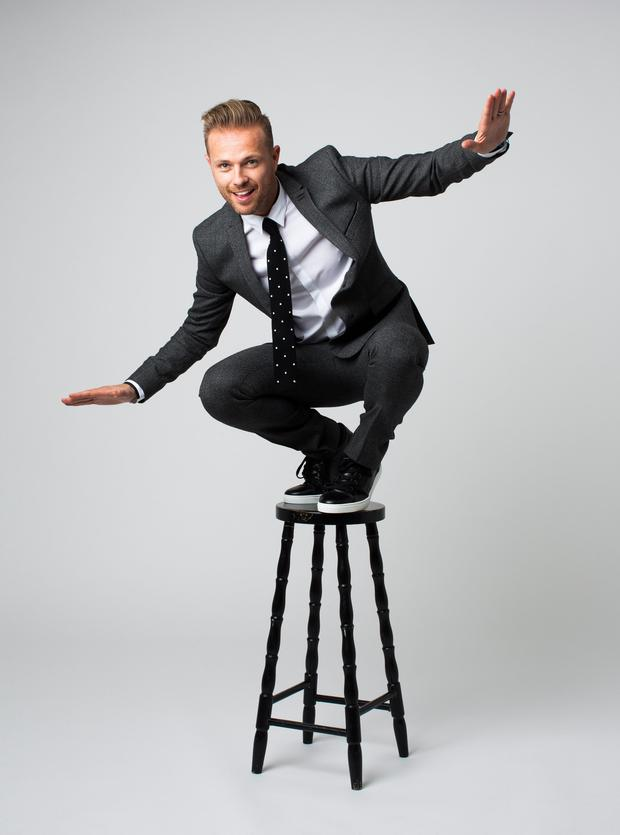 Finely balanced: Nicky Byrne wears Jacket, €425, trousers, €225, shirt, €165, all The Kooples; Tie, €115, Ted Baker; Trainers, €395, Dolce & Gabbana. Photo: Mark Nixon.
