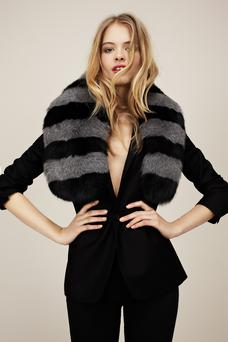 Faux fur: Scarf, €211; available in store late August, Style Ikon, 18a The Crescent, Monkstown, Co Dublin, or order