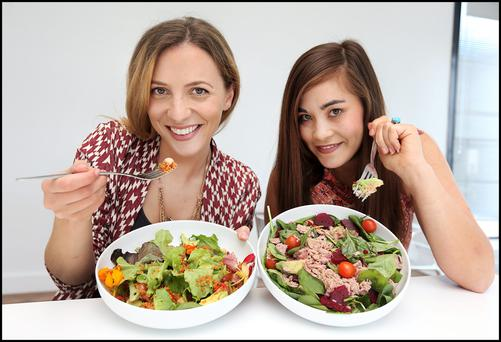 How do you eat yours: Stella Forte and Gillian Tsoi compare their home-made salads at lunchtime. Photo: Steve Humphreys