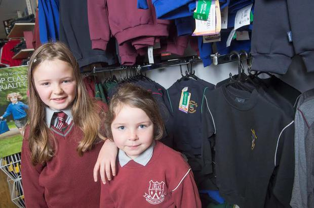 Back to school: Molly and Aoife Clifford getting fitted for their school uniforms, in Fermoy, Co Cork. Photo: Michael MacSweeney.