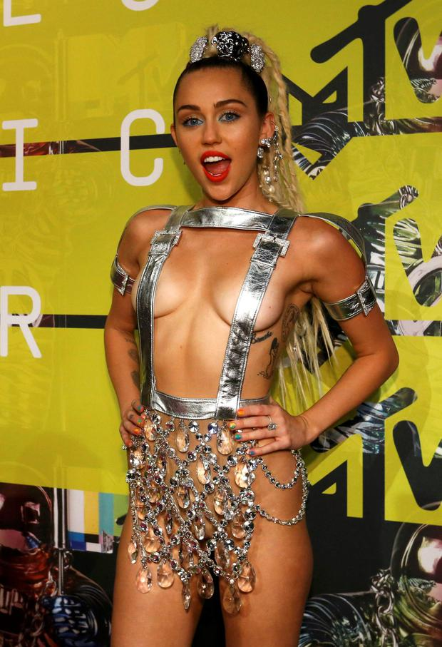 Dressed to thrill: Miley Cyrus stole the show again with another risque outfit at VMAs