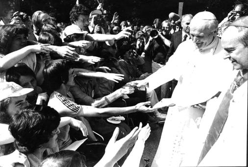 Blessings: Pope John Paul II meets the gathered crowds with Cardinal Ó Fiaich in Phoenix Park