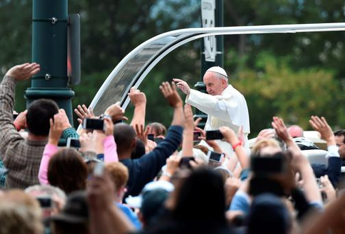 Pope Francis waves during a parade en route to an open-air Mass in Philadelphia, Pennsylvania. Photo: Getty