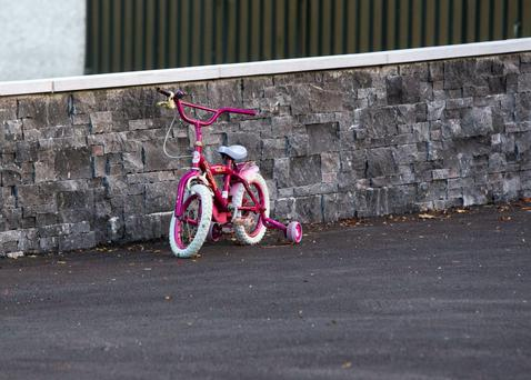 A child's bicycle outside the Corcoran home