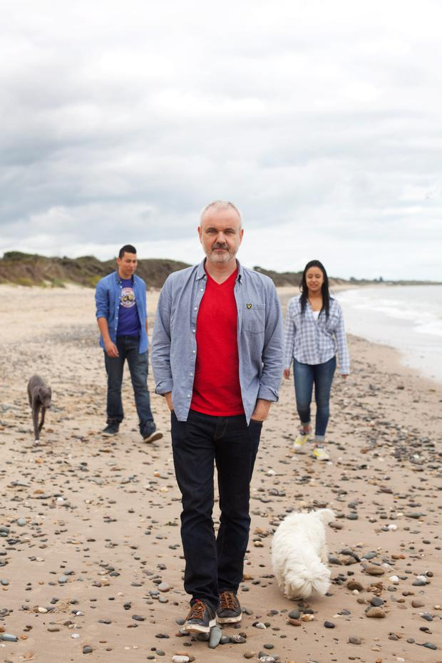 Colm O'Gorman with his son Sean and daughter Safia in the background.