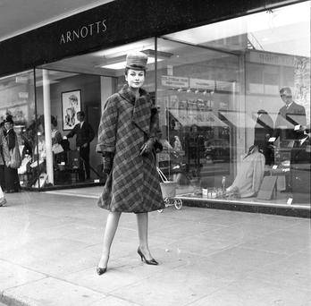 Grace O'Shaughnessy wearing a tweed coat outside Arnotts department store, October 1962.