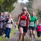 Sinead Kane running in the Donadea 50k in February 2015, with her guide John O'Regan behind her.