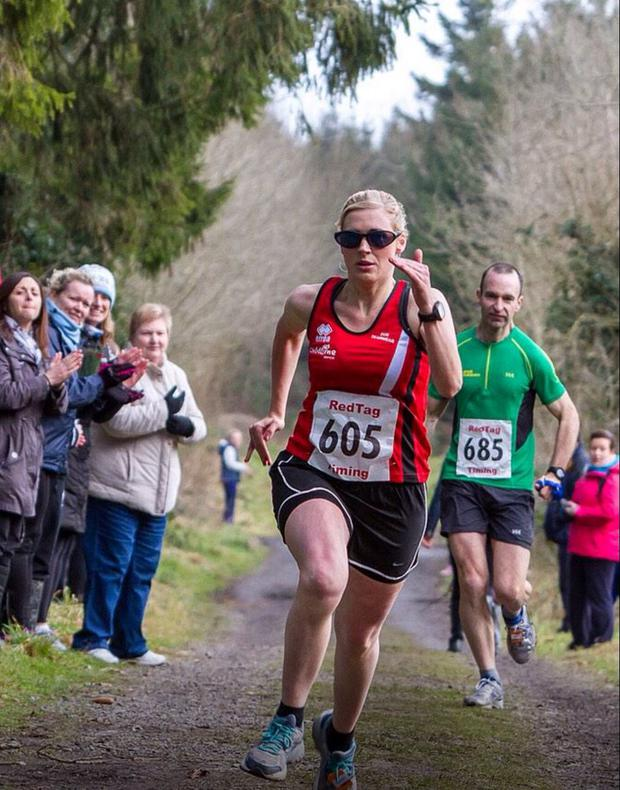 Sinead Kane running in the Donadea 50k in February this year, with her guide John O'Regan behind her.